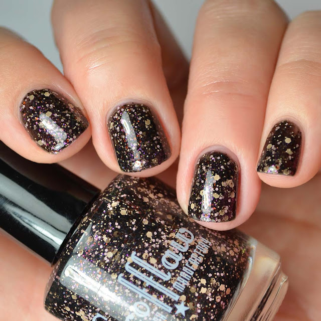 black nail polish with peach and pink glitter swatch