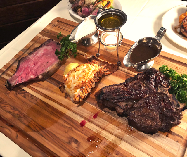 Butcher's Block featuring Porterhouse, Slow Roasted Prime Rib and African Cold-water Lobster Tail at Palm Court in Arlington Heights, IL