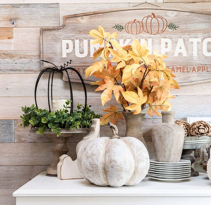 Wood wall, white dresser with farmhouse pumpkins and Fall decor