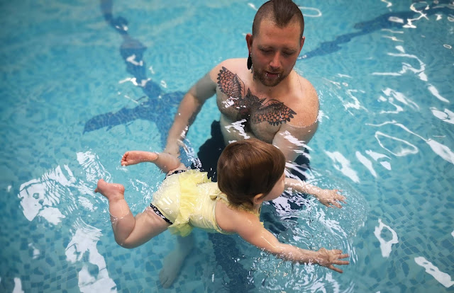A picture of a baby learning to swim with Splash Babies Leicestershire based swimming classes