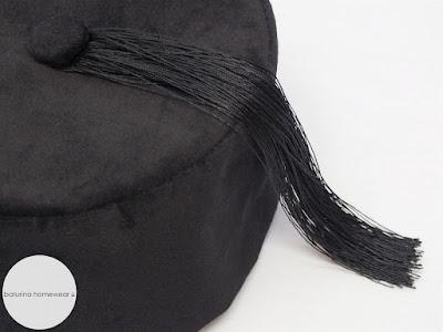 Men's classic victorian style black velvet smoking cap with tassels.