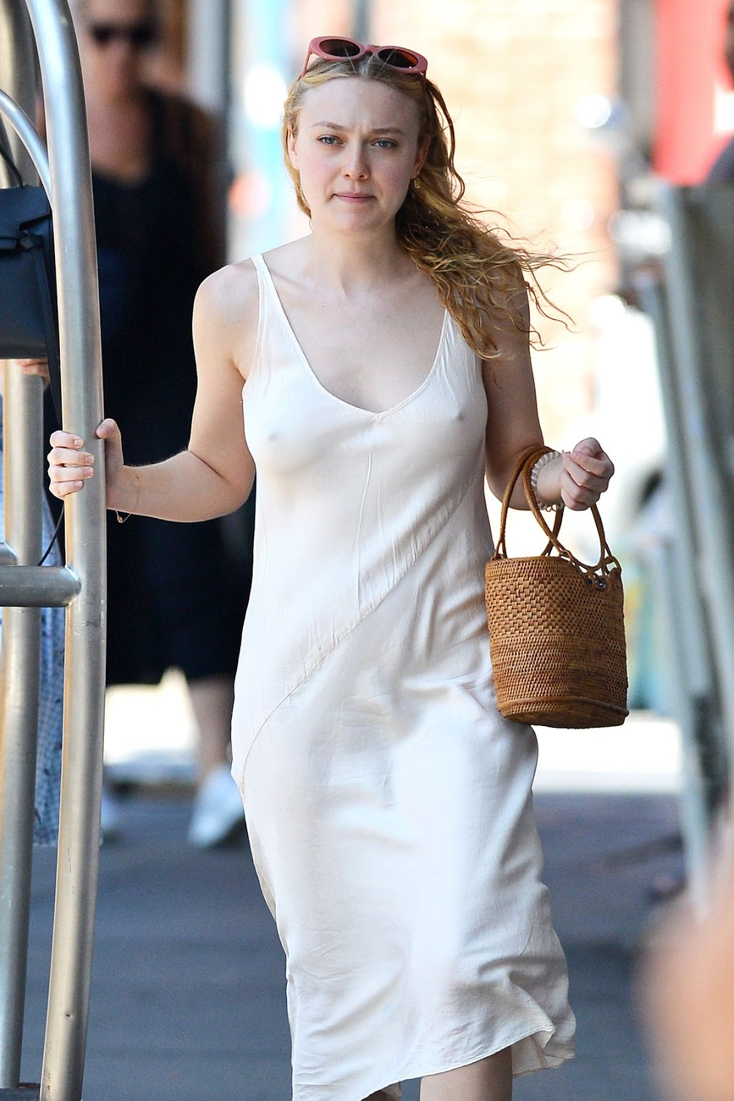 Dakota Fanning goes braless in nude slip in New York City