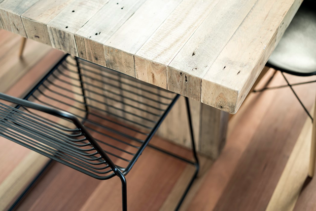 An industrial-style wooden table with metal chairs