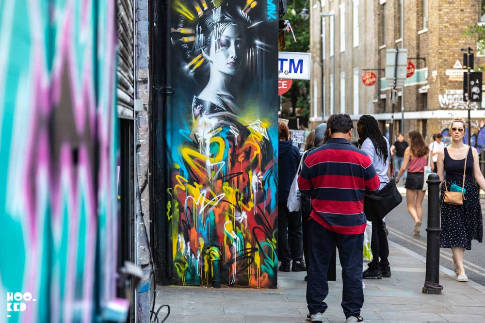 Street Artist Dan Kitcheners Queen Of Colours Mural on Brick Lane, London