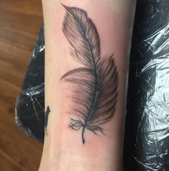 50 Best Feather Tattoos With Birds Meaning 2019 Phoenix Peacock