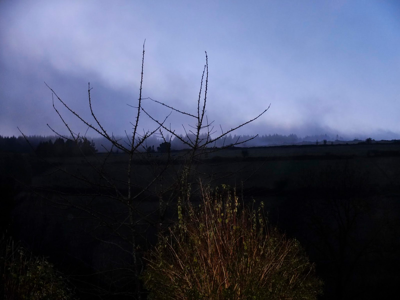 Clouds rolling over the top of a hill side in North County Cork.