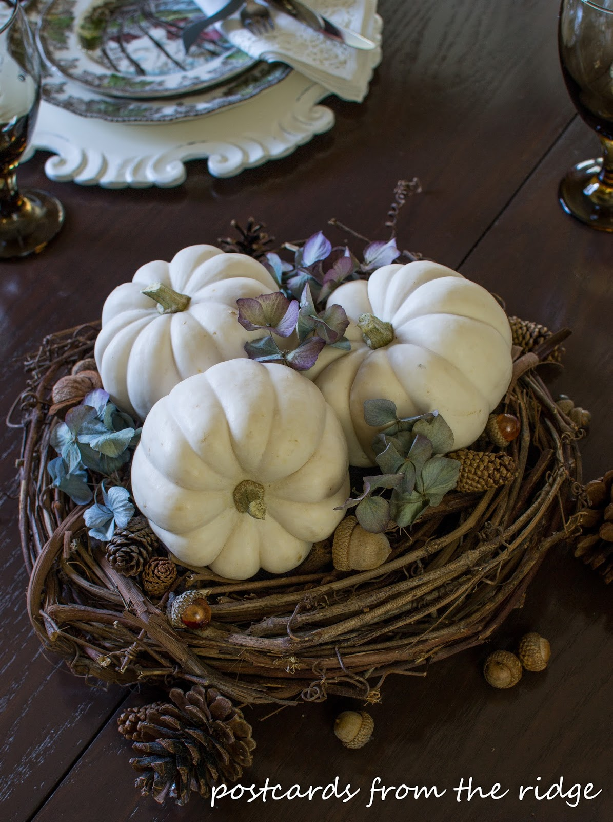I love white pumpkins! Such a pretty centerpiece and lots of other great ideas for fall decor using vintage and farmhouse style items.