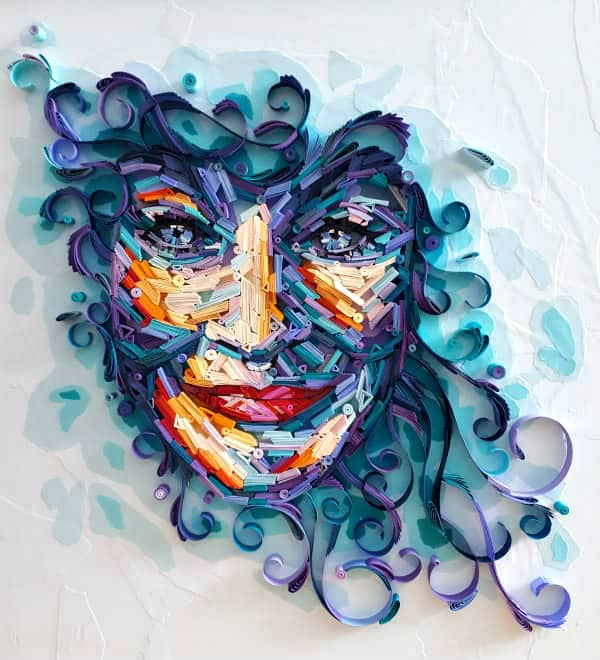 on-edge quilled paper portrait of smiling woman