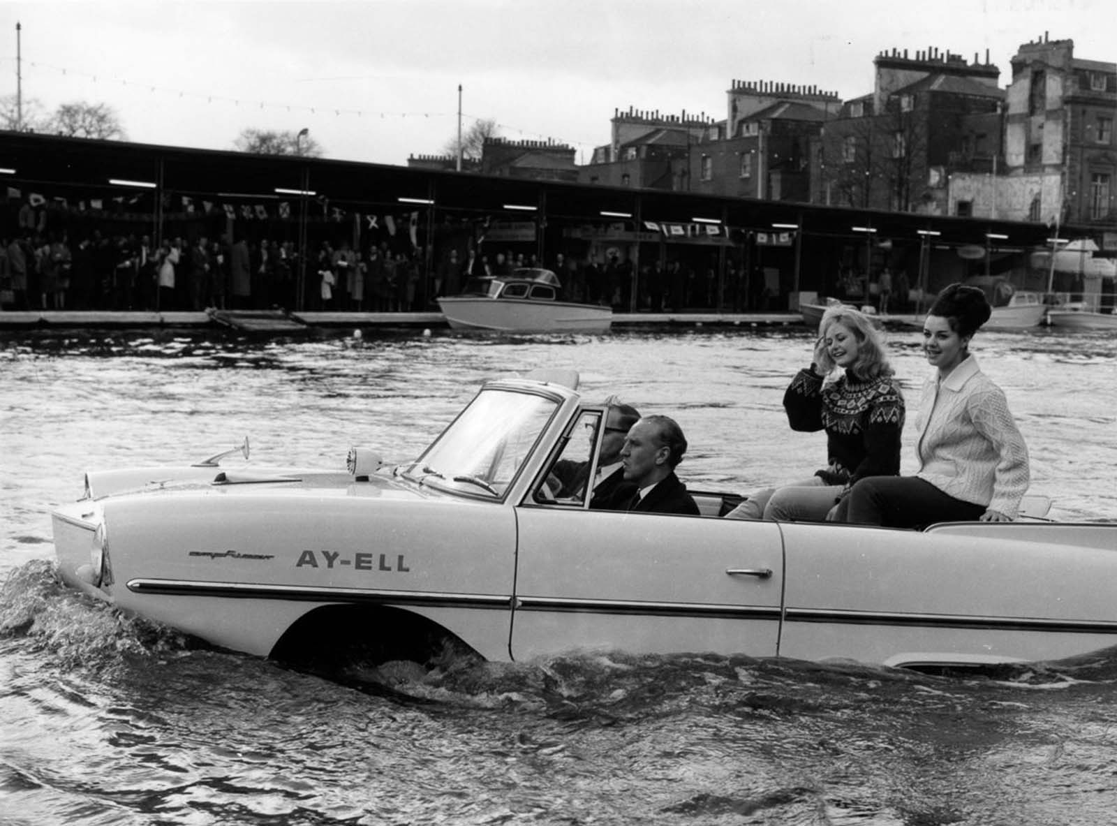 British Transport Minister Ernest Marples takes a ride in the Amphicar in London. 1964.