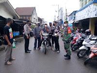 Team Gempur Covid - 19 Polsek Tanjung Beringin Giat Ops Yustisi di depan Pasar Rakyat Tradisional