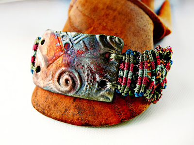 Micro macrame bracelet with raku ceramic focal.