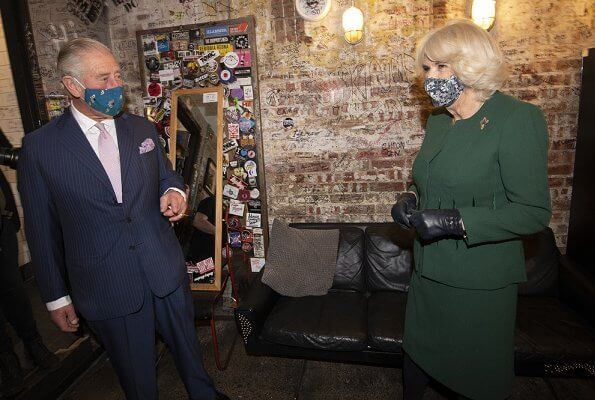The Duchess of Cornwall wore a green skirt suit and black cape
