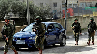A Hamas official in the occupied West Bank says Israeli forces have arrested dozens of Hamas supporters, including lawmakers, in overnight raids.