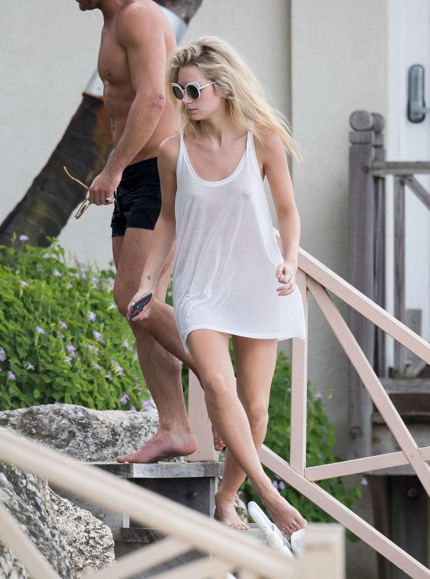 Lottie Moss goes braless on vacation with boyfriend