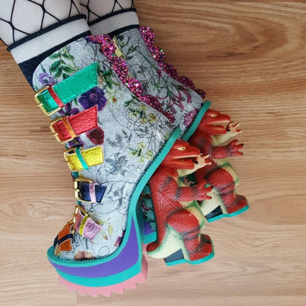 multi coloured dinosaur heel shoes with floral uppers and fishnet tights