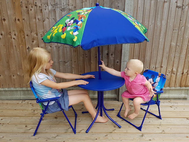 Blue table, chairs and sun umbrella with Mickey Mouse theme