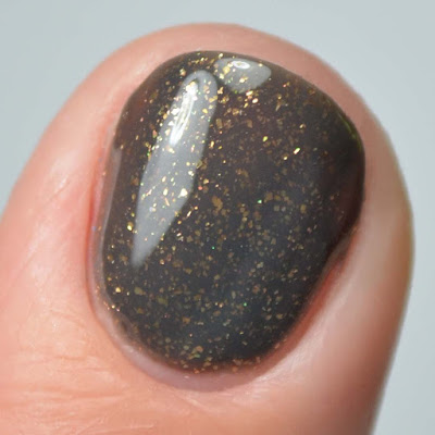 grey nail polish with bronze flecks close up swatch