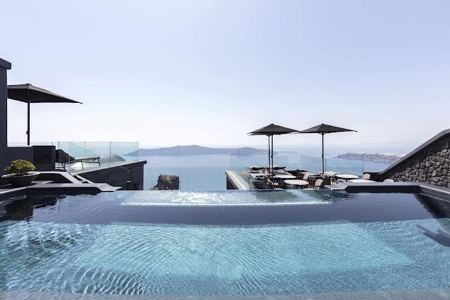A luxury hotel in Santorini overlooking the sea