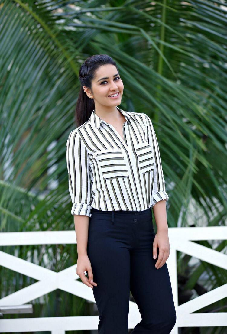 South Indian Actress Rashi Khanna Photoshoot In White Shirt Blue Pant