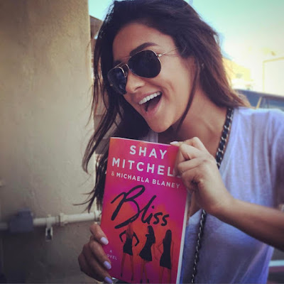 Troian Bellisario wishes happy birthday to Shay Mitchell with photo of Shay holding novel Bliss