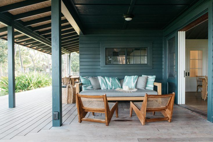 Porch area of beautiful oceanfront cottage on Maui - found on Hello Lovely Studio
