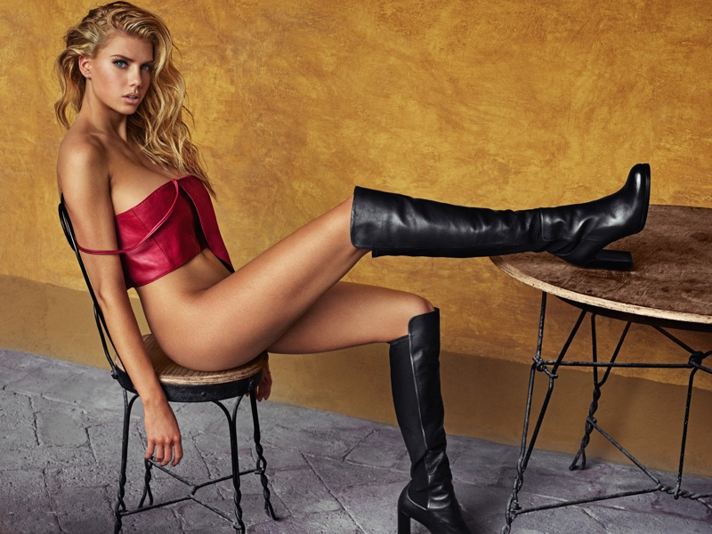 Charlotte McKinney wears black knee-high boots for GQ Mexico