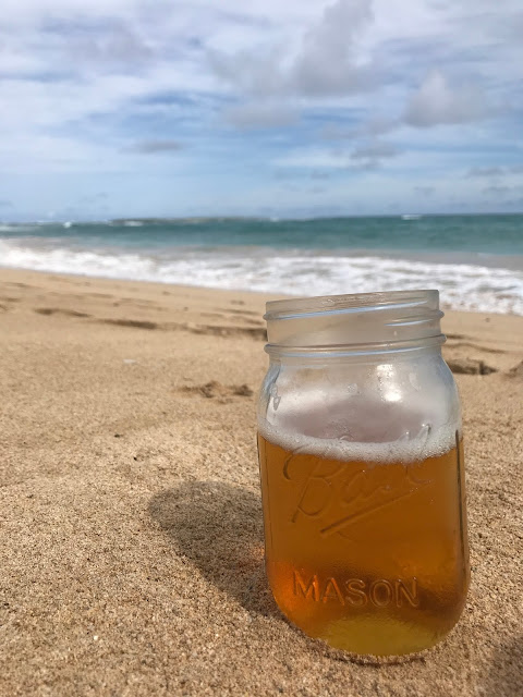 Beer in a mason jar on the beach