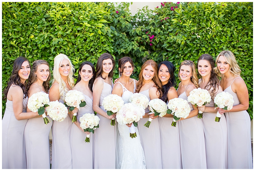 bride with bridesmaids in mauve blush dresses at Montelucia