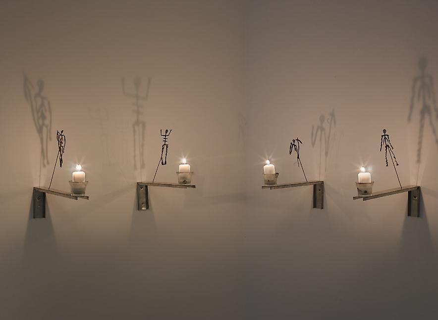 Christian Boltanski, Shadows from the Lesson of Darkness, 1987 Installation, Sculpture, 12 oxidized copper figures, candles