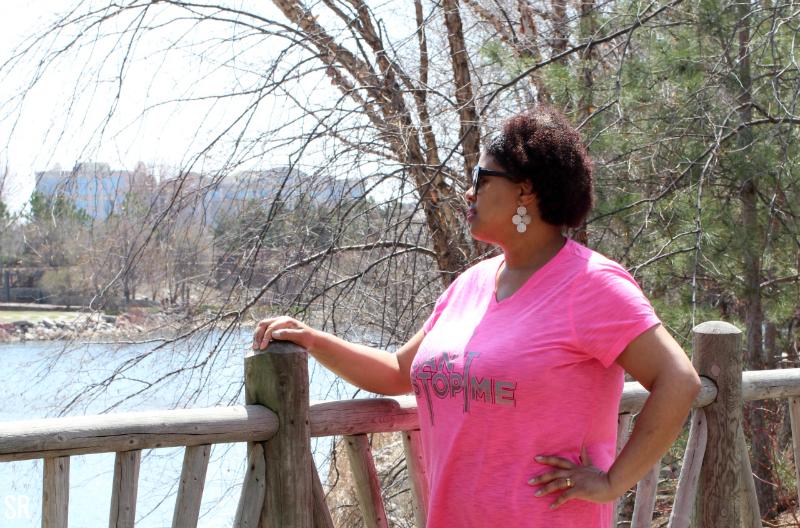 a woman standing on a bridge