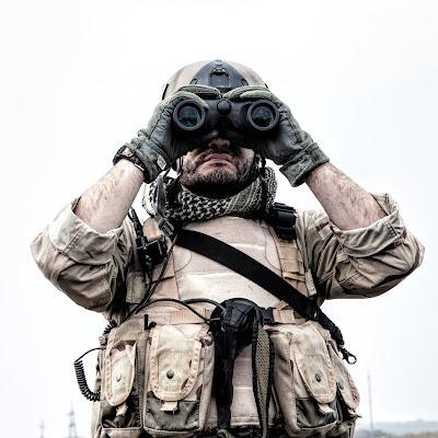 sf operator looking trough binoculars