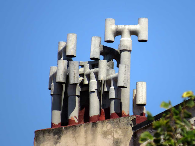 Chimneys on a roof, seen from piazza della Vittoria, Livorno