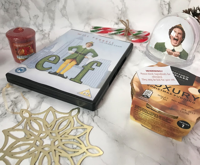 elf dvd, candy canes, Christmas pudding, snow globe, candle