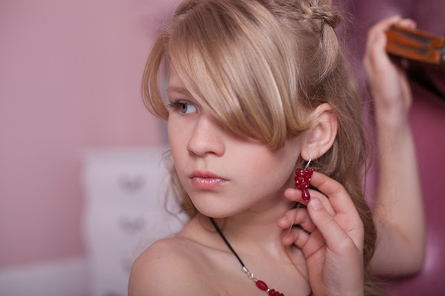 Blonde girl wearing red drop earrings