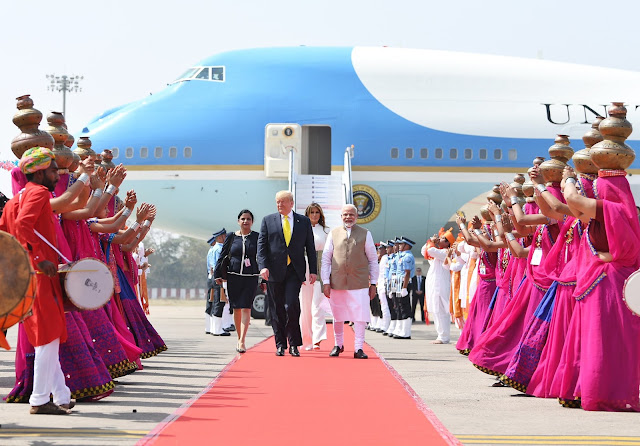 Image Attribute: President Donald Trump and First Lady Melania Trump received by Prime Minister Narendra Modi at Ahmedabad International Airport / Date: February 24, 2020 / Source: PMO