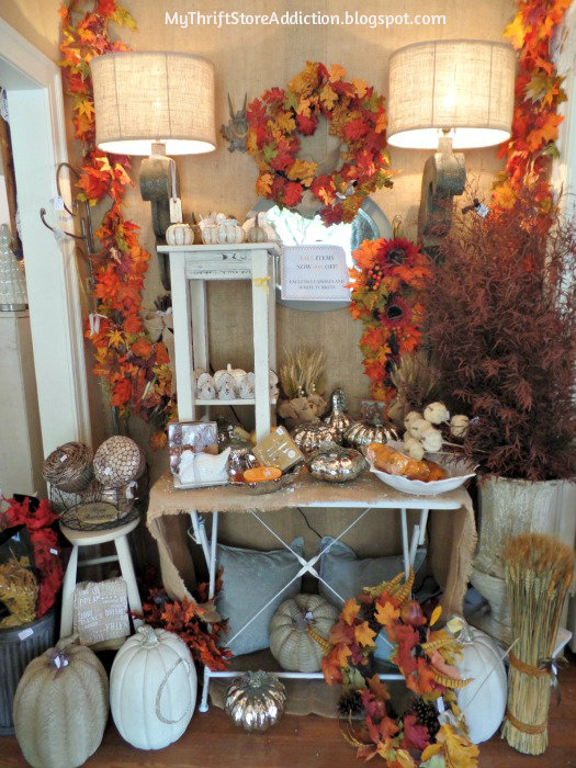 Smitten! mythriftstoreaddiction.blogspot.com Glorious fall display at entrance of the store