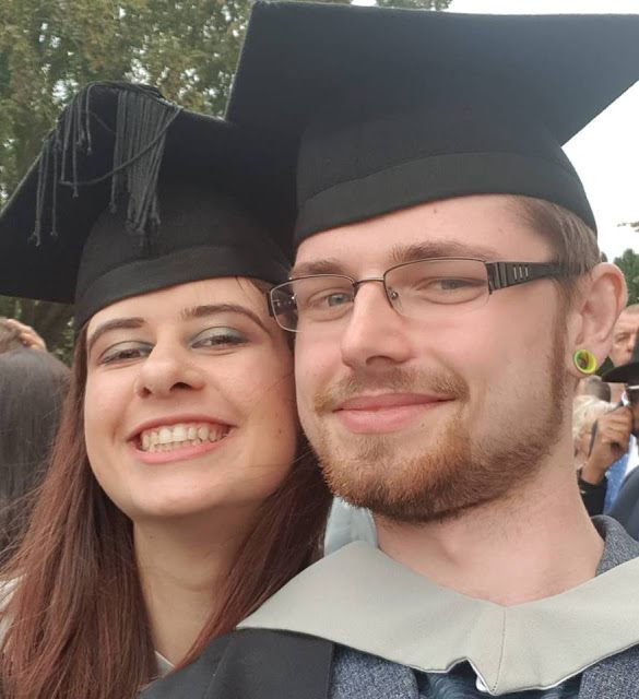 Laura is at her graduation ceremony with her partner