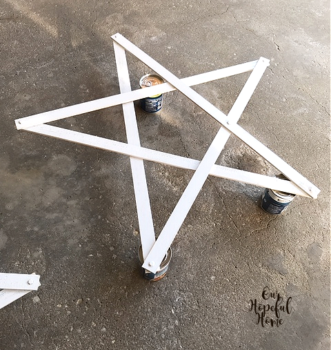 white painted wooden star soup cans