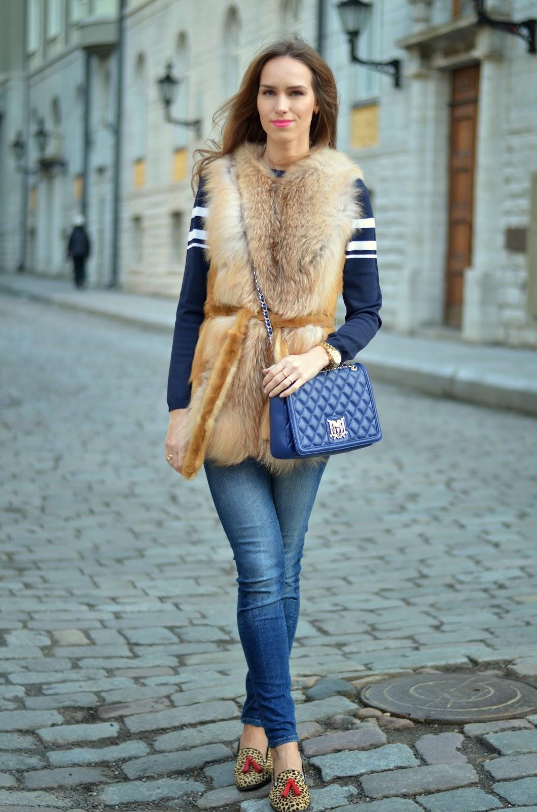 kristjaana mere fur vest skinny jeans leopard print tassel shoes spring outfit