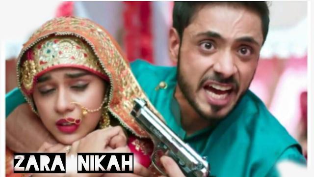 "<img src=""zara nikah.png"" alt=""man holding a gun to a woman head on zara nikah zeeworld."">"