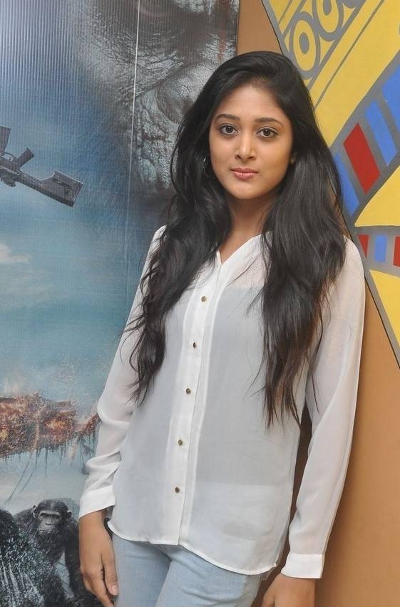 Telugu Hot Girl Sushma Raj Images In White Shirt Blue Jeans At Movie Premier Show