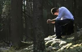 Man praying in the woods
