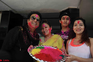 Govinda celeting Holi with His family wife daughter 003.JPG