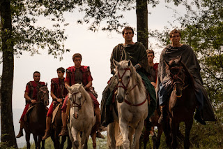 Roman soldiers riding through forest