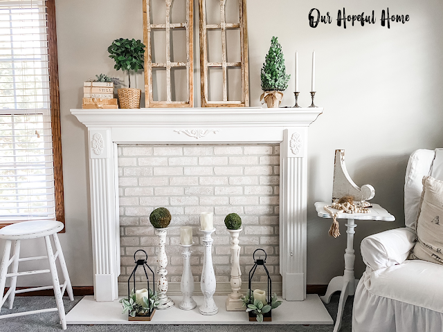 white painted wooden stool topiaries arches candles