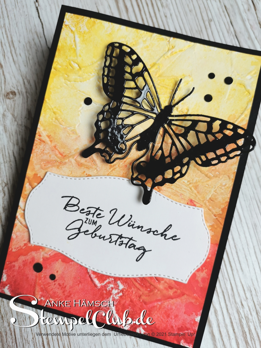 DIY Grußkarte mit Farbverlauf  rot, orange, gelb und schwarzem Schmetterling