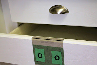 nickel plated cup pulls on white drawer