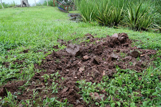 Lightning strike hits ground and digs hole