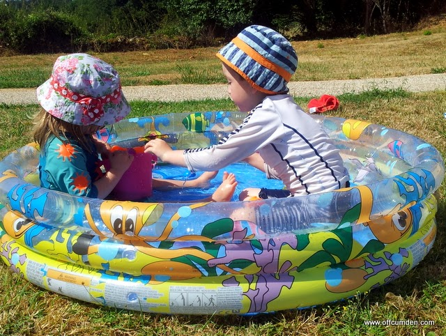 Playing in a paddling pool