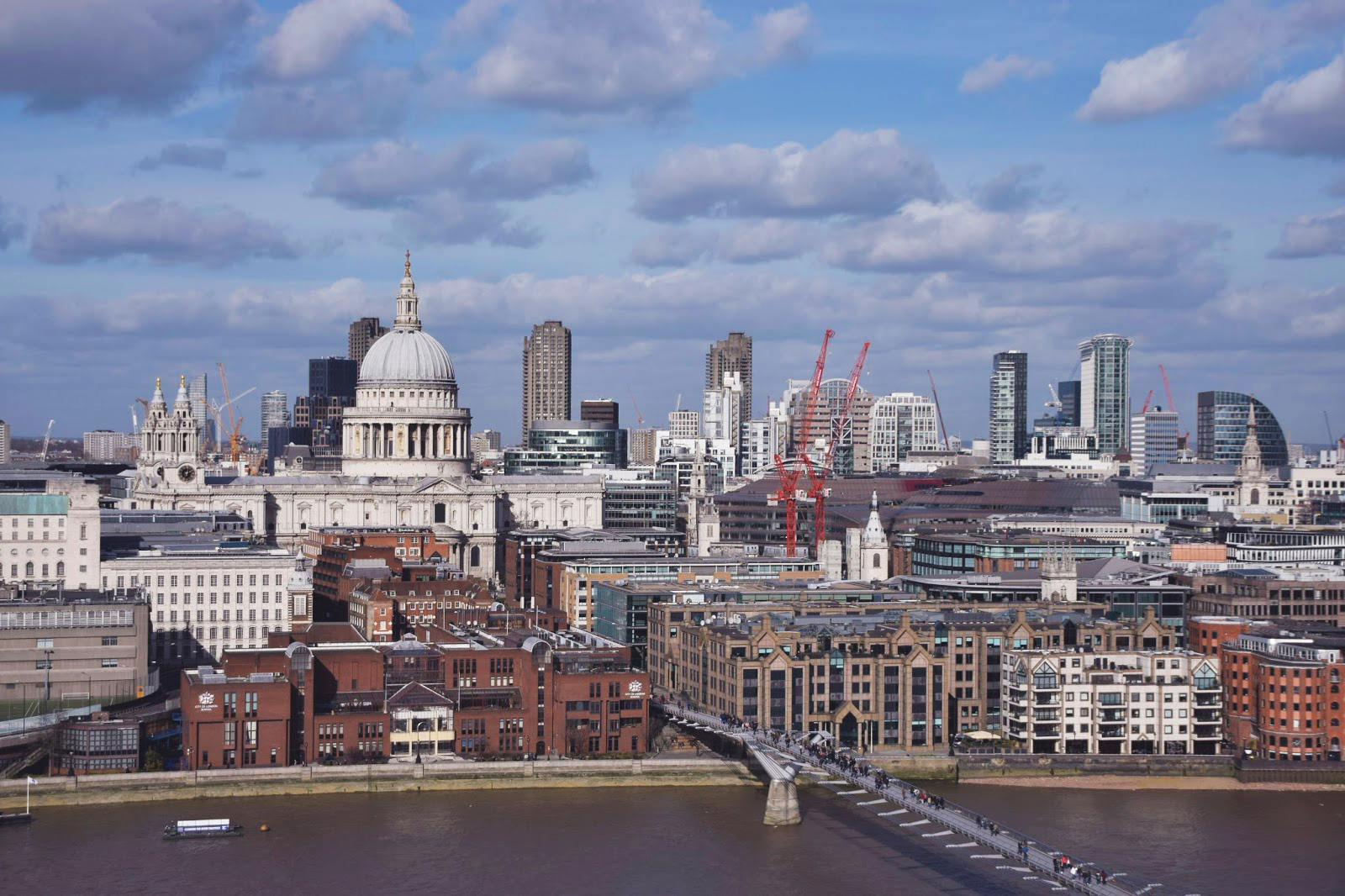 Taken from the top of the Tate Modern gallery in London. The London skyline is in full view with noticeable buildings such as St Pauls down below.